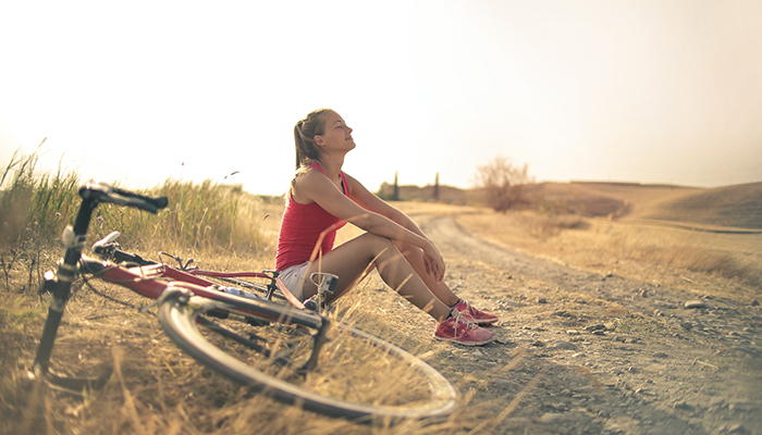 woman with a bicycle in a good mood