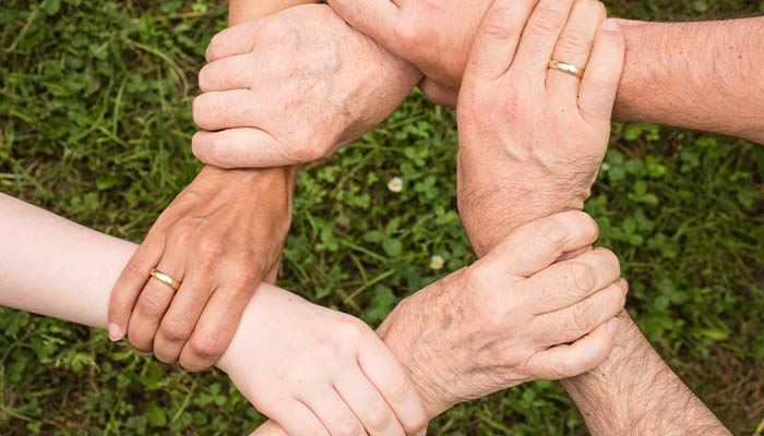 grabbing hands to help each other mentally